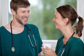 Surgeon Holding Coffee Mug While Looking At Coworker — Stock Photo