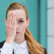 Closeup Of Businesswoman Covering Eye — Stock Photo