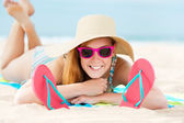 Smiling Woman Sunbathing On Beach — Stock Photo
