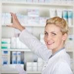 Female Pharmacist With Prescription At Drugstore — Stock Photo