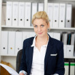 Blond Businesswoman Reading Application Folder — Stock Photo
