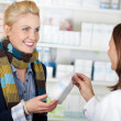 Customer Buying Medicine At Pharmacy — Foto Stock #26579979