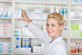 Female Pharmacist With Prescription At Drugstore — Stock Photo