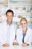Two Pharmacists At Drugstore — Stock Photo