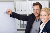 Confident Businesspeople Working On Flipchart — Stock Photo