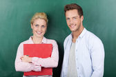 Portrait Of Business Couple Against Green Background — Stockfoto