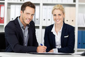 Young Business Team At Office Desk — Stock Photo