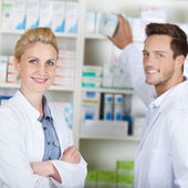Two Young Pharmacists At Drugstore — Stock Photo