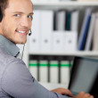 Closeup Portrait Of A Young Man With Headset — Stock Photo #26580181