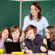 Stock Photo: Teacher and schoolchildren