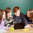 Schoolchildren with laptop — Stock Photo