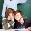 Two young boys sharing secrets — Stock Photo