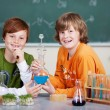 Two young students in chemistry class — Stock Photo