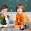 Two young students in chemistry class — Stock Photo #26589169