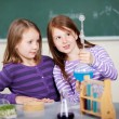 Young girls doing a chemistry experiment — Stock Photo