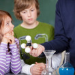 Teacher explaining an atomic model — Stock Photo