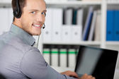 Closeup Portrait Of A Young Man With Headset — Stock Photo