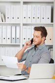 Businessman On Call Looking At Paper — Stock Photo