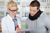 Customer Buying Medicine At The Pharmacy — Stock Photo