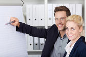 Happy Businesspeople Working On Flipchart — Stockfoto
