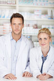 Two Serious Pharmacists At Drugstore — Stock Photo