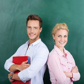 Portrait Of Students Against Green Background — Stock Photo