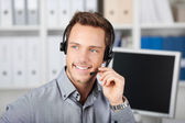 Smiling Young Man With Headset — Stock Photo