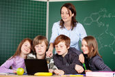 Teacher and schoolchildren — Stock Photo