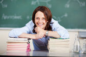Smiling female teacher in class — Foto de Stock