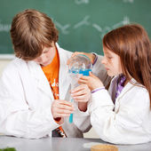Young students learning chemistry — Stock Photo