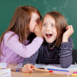 Two girls whispering in class — Stock Photo #26590015