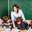 Stock Photo: Teacher and pupils