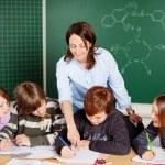 Teacher and pupils — Stock Photo