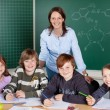 Stock Photo: Happy class of young pupils