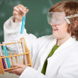 Young boy watching a chemical reaction — Stock Photo #26597033