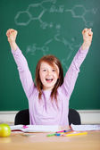 Jubilant little girl in school — Stock Photo