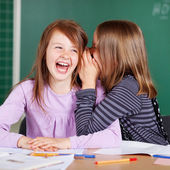 Two little girls sharing secrets — Stock Photo