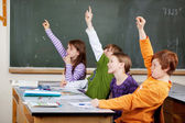 Clever young students in class — Stockfoto