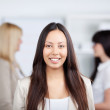 Businesswoman Smiling With Female Coworkers In Background — Stock Photo