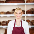 Confident saleswoman in bakery — Stock Photo