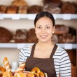 Teenage Waitress Holding Bread Basket — Stock Photo #26604917