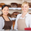 Waitresses Standing Together At Cafe Counter — Stock Photo #26605117