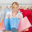 Curious Woman Looking In Shopping Bag — Stock Photo