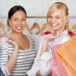 Female Friends Holding Shopping Bags In Shop — Stock Photo