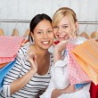 Two friends having fun going shopping — Stock Photo