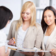 Three young businesswomen in the office — Stock Photo