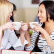 Women Holding Coffee Cup While Looking At Each Other — Stock Photo #26606607