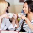 Women Holding Coffee Cup While Looking At Each Other — Stock Photo