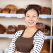 Confident Teenage Girl With Arms Crossed At Coffeeshop Counter — Stock Photo