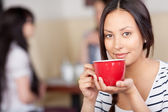 Businesswoman Drinking Coffee In Office Cafe — Stock Photo